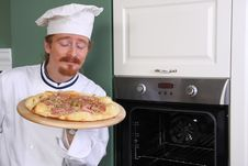 Young Chef Smelling Italian Pizza Royalty Free Stock Photography
