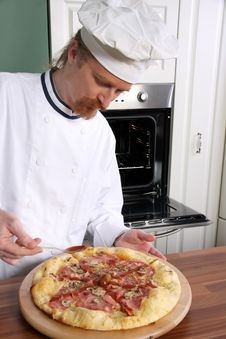 Free Young Chef Prepared Italian Pizza Stock Image - 23398671