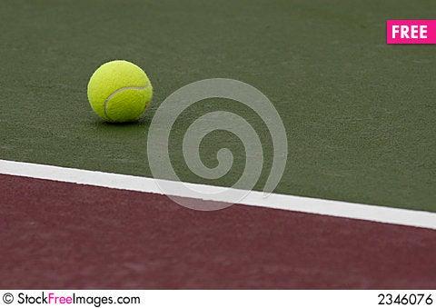 Tennis Ball on Court Stock Photo