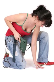 Woman And A Drill Stock Photo