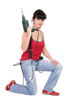 Woman And A Drill Royalty Free Stock Image