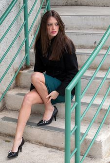 Woman On Outdoor Stairway Stock Images