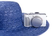 Free Small Digital Camera And Straw Hat Royalty Free Stock Photography - 23421207