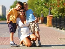 Young Pregnant Mother With Two Sons Stock Photo