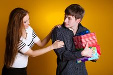 Young Couple With A Gift Stock Images