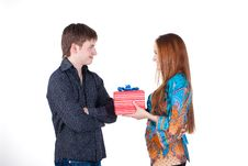 Young Couple With A Gift Isolated Stock Images