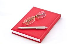 Free Glasses And The Pen On The Book Stock Photography - 23439272