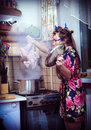 Free Housewife With Carcass Of A Hen In Hands Royalty Free Stock Photos - 23442578