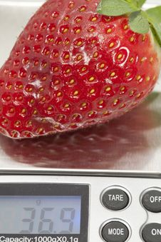Free Weighing A Strawberry Royalty Free Stock Images - 23441119