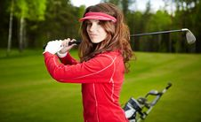 Woman Playing Golf On A Green Woman Stock Images