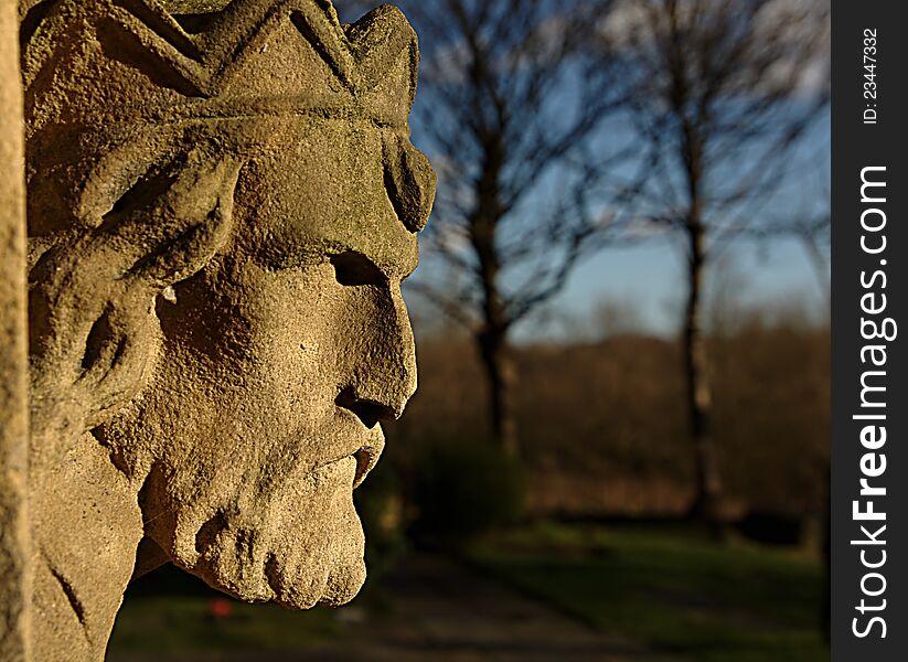 Stone head overlooking churchyard