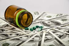 Free Medicine On Dollars Royalty Free Stock Image - 23457876