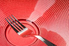 Free Fork On Red Plate Royalty Free Stock Photography - 23458047