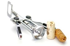Corkscrew And Two Wine Corks Royalty Free Stock Image