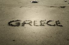 Free Greece, Letters On The Sand Stock Photo - 23459480