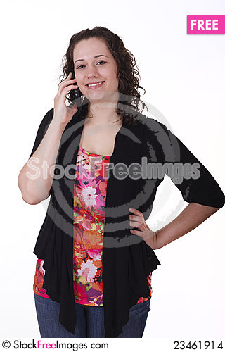 Free Young Brunette In Black Sweater Smiling On Phone Stock Images - 23461914