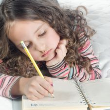 Little Girl With Notebook And Pen