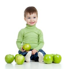 Free Adorable Child With Green Apples Stock Photography - 23466962