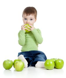 Adorable Child With Green Apples Stock Photo