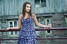Free The Girl Next To A Wooden House Royalty Free Stock Photos - 23473888