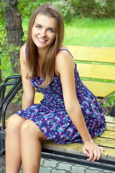 Free Girl Sitting On A Bench Stock Photography - 23474202