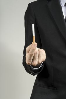 Free Handsome Guy Shows Cigarettes Stock Photography - 23475932