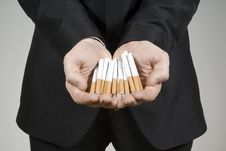 Free Handsome Guy Shows Cigarettes Royalty Free Stock Photography - 23476107