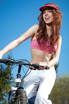 Free Woman On A Bicykle Outdoors Smiling Royalty Free Stock Photo - 23479285