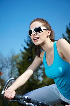 Free Woman On A Bicykle Outdoors Smiling Stock Images - 23479464
