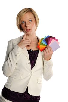 Free Young Businesswoman Holding Color Swatches Royalty Free Stock Image - 23483616