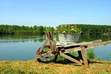 Old Wooden Wheel Barrow Stock Photo
