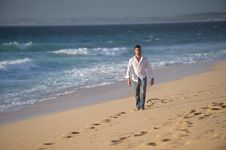 Man Walking Alone At The Beach Royalty Free Stock Image