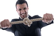 Free Business Man Pulling And Bond Tied With Rope Conc Stock Photos - 23497873