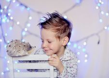 Free The Child And A Garland Royalty Free Stock Photography - 23498457