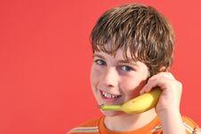 Free Kid On Bannana Phone Royalty Free Stock Photo - 2350805