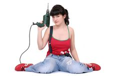 Pretty Woman With A Drill Royalty Free Stock Photos
