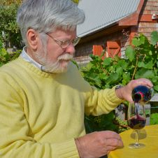 Free Senior Male Pouring A Glass Of Red Wine Stock Photos - 23504323