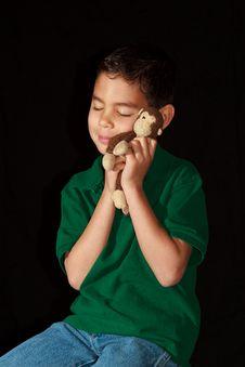 Free Boy Hugging Stuffed Monkey Royalty Free Stock Photo - 23504595