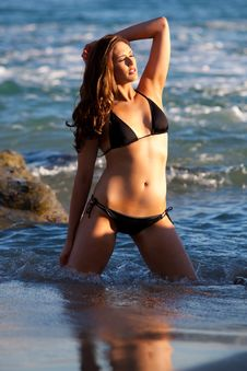 Model Standing In Water At Beach Stock Photography
