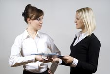 Free Beautiful Girls Send Documents To Each Other Stock Image - 23508451