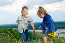 Little Girl And Boy Play And Cheered Outdoors Stock Images