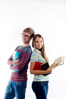 Male And Female Students Standing Back To Back Royalty Free Stock Images
