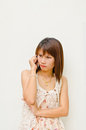 Free Pretty Asian Girl Talking  By Cellphone Stock Photography - 23528982