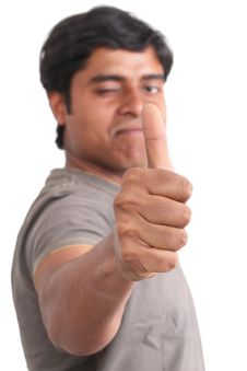 Portrait Of Happy Young Indian Giving Thumbs Up Stock Images