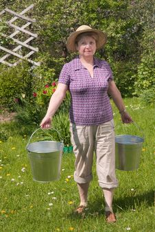 Free The Rural Woman With A Bucket Royalty Free Stock Images - 23526919
