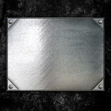 Steel Metal Plate On Concrete Wall Stock Image