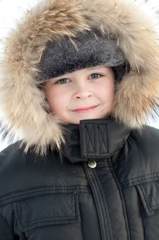 Boy In A Jacket With Fur Royalty Free Stock Photography