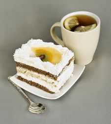 Piece Of Cake With Fruit, Tea With , Spoon Royalty Free Stock Photography