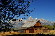 Free Tree Framing An Old Barn With Snow Capped Mountain Stock Images - 23535084