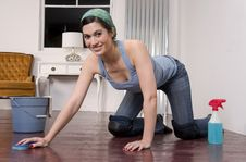 Free Attractive Housekeeper Maid Cleaning Wood Floor On Royalty Free Stock Photo - 23536545